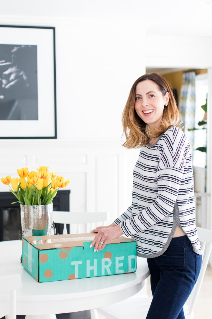 EVa Amurri Martino prepares to open her cardboard box of secondhand clothes from ThredUP