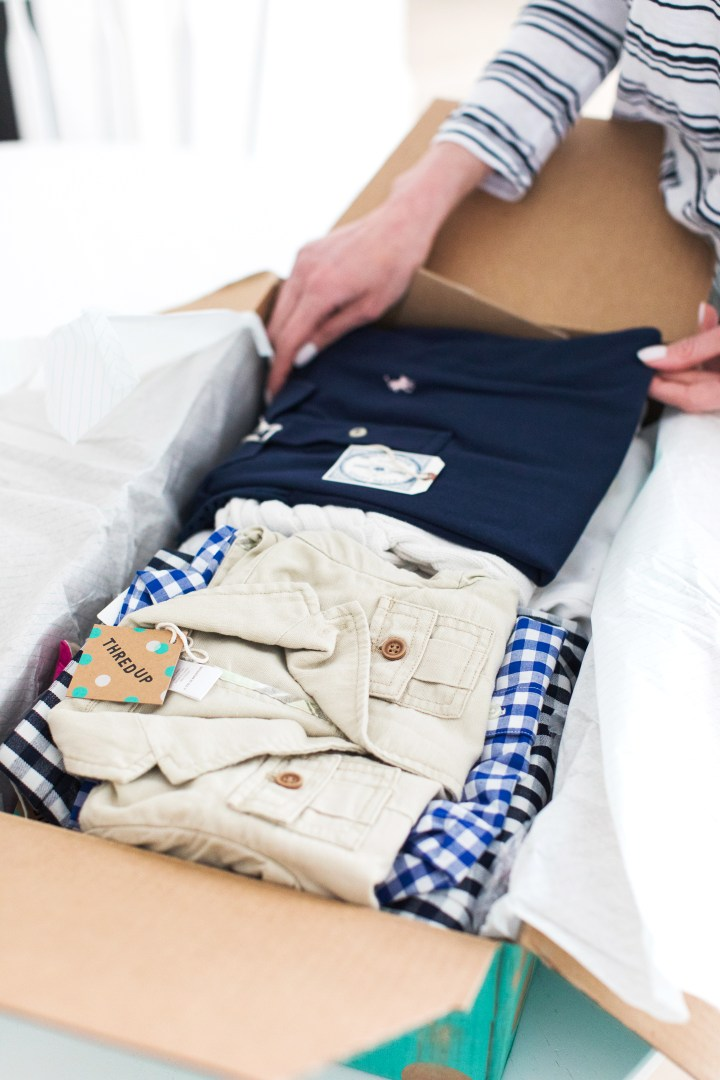 A detail shot of the secondhand clothing items beautifully packaged in the polka dot box