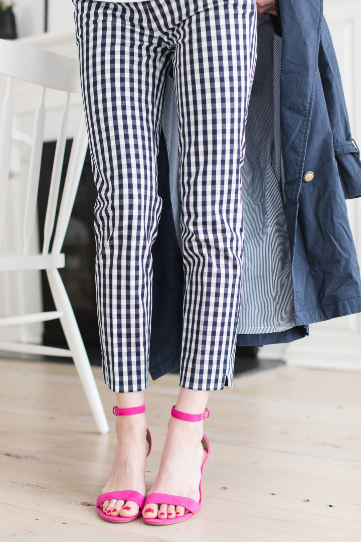 Blue and white gingham pants, hot pinks heels, and a navy trench are all part of a secondhand outfit of clothes put together by Eva Amurri Martino from thredUP