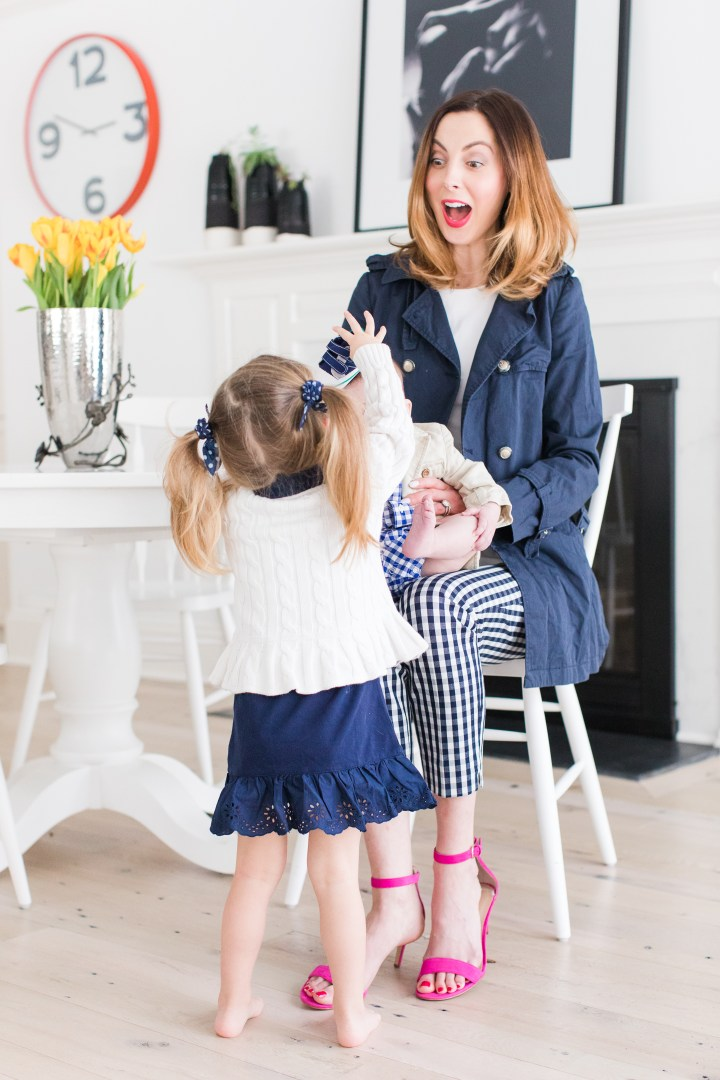 Eva Amurri Martino sits with her daughter Marlowe and son Major in the kitchen of their Connecticut home wearing coordinating navy and white outfits