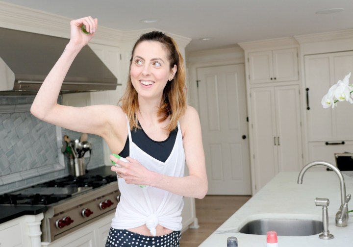 Eva Amurri Martino sprays the new JASON dry spray deodorant before heading out to her workout