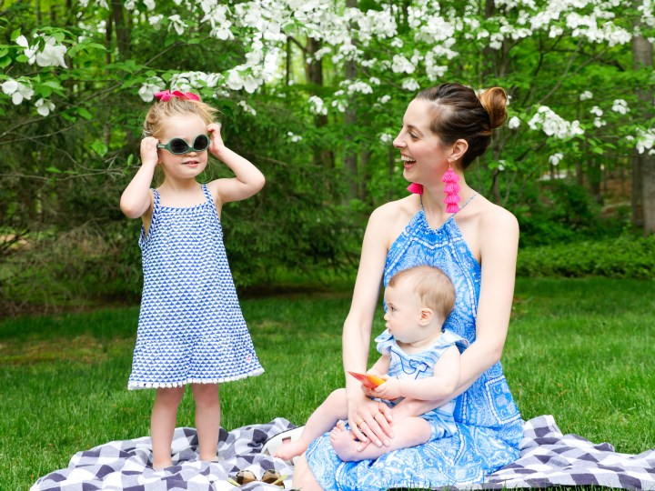 Eva Amurri Martino laughs on a picnic basket with her children, as Marlowe tries on a pair of sunglasses