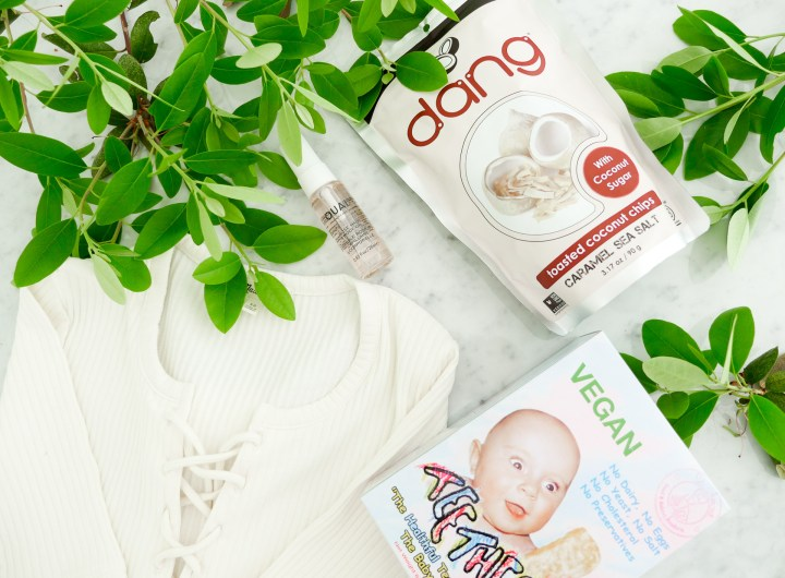 Eva Amurri Martino shares a roundup of her monthly obsessions for June, including a package of teething biscuits, coconut chips, a rose hair oil, and a lace up bodysuit