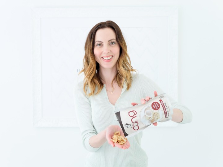 Eva Amurri Martino pours out some Dang coconut chips as part of her monthly obsessions roundup