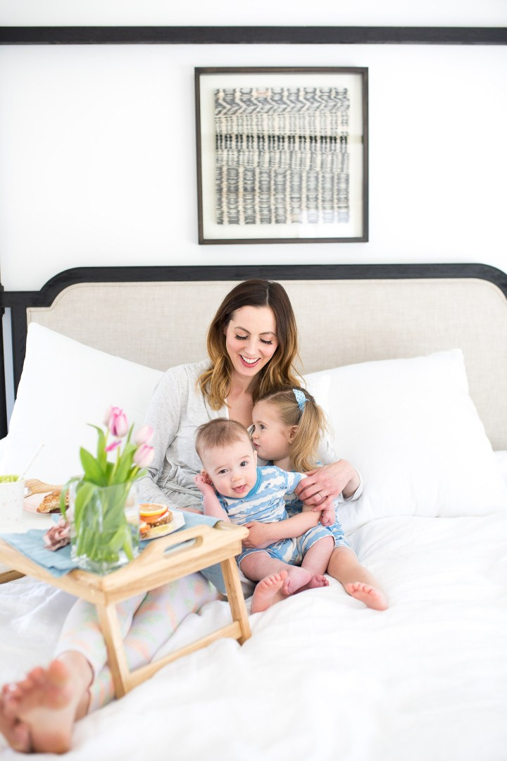 EVa Amurri Martino balances her two children on her lap while eating a yummy Mother's Day breakfast in bed