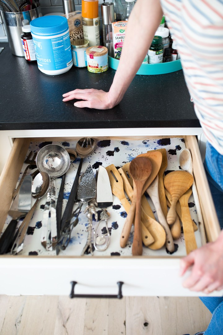 A wallpaper-lined serving implement drawer in Eva Amurri Martino's Connecticut kitchen