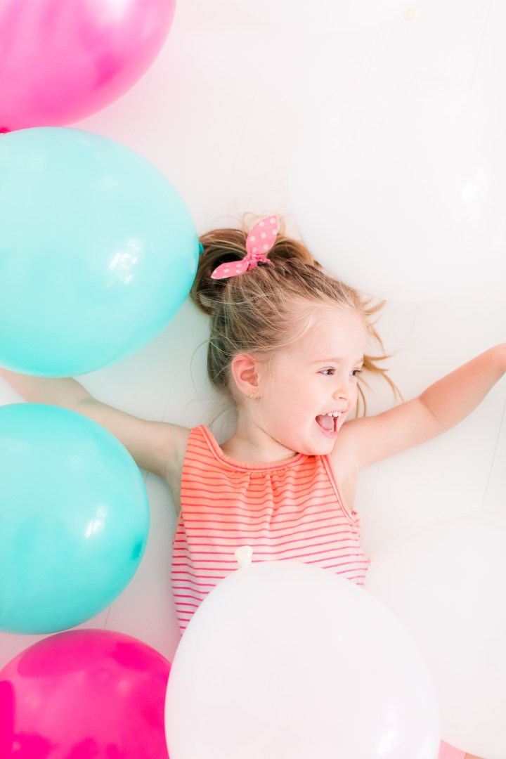 Marlowe Martino plays in multicolored balloons for the Happily Eva After second anniversary