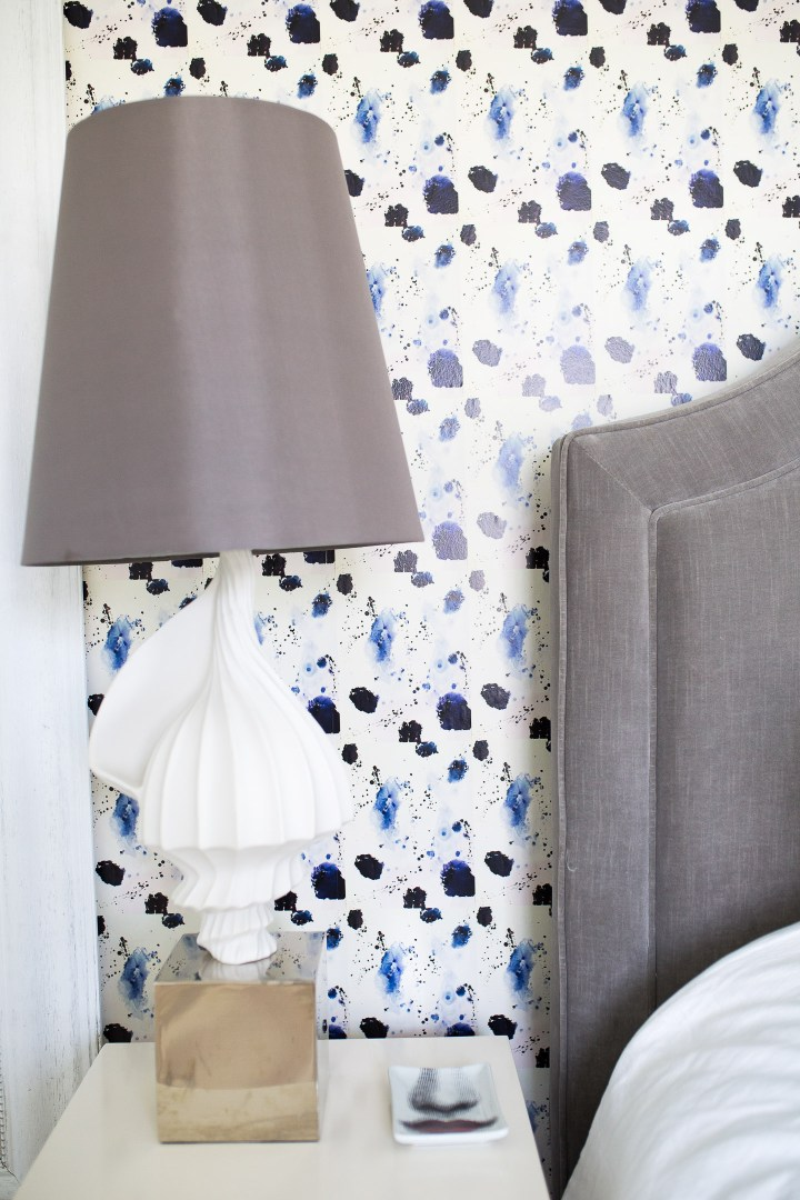 A detail of the bedside table and fun wallpaper in the guest room of Eva Amurri Martino's connecticut home
