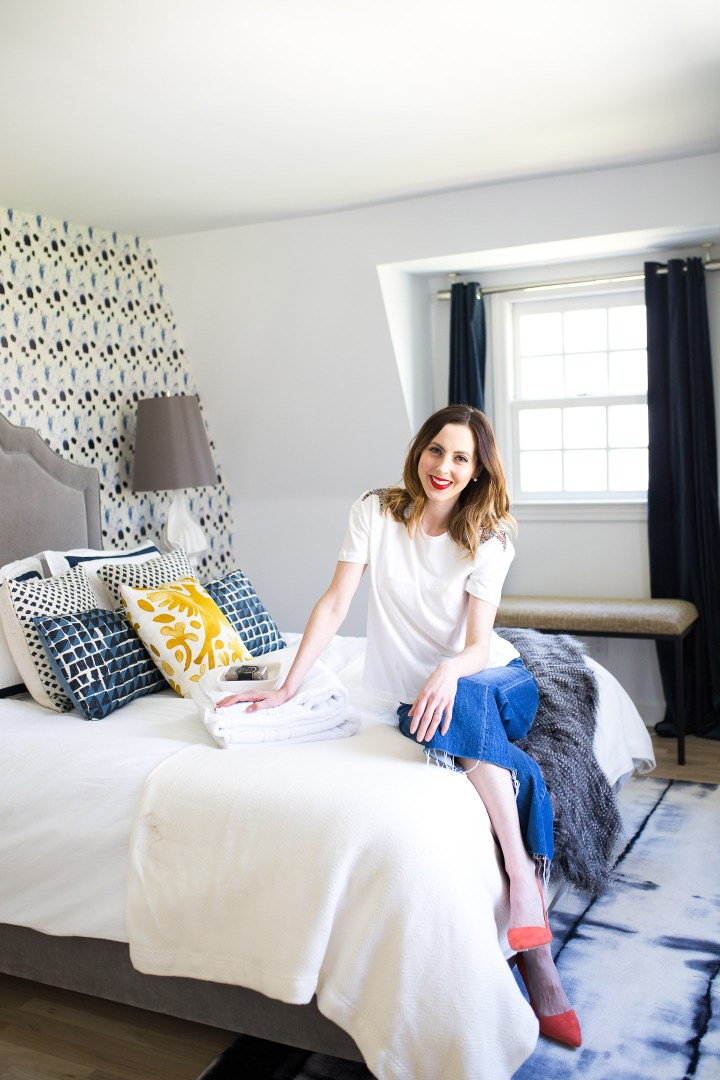 Eva Amurri Martino lounges on the bed in her newly revamped Guest Room in Connecticut