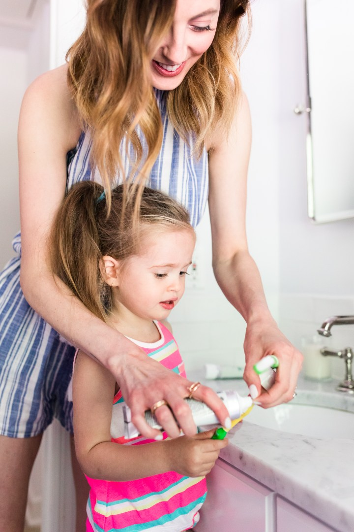 Eva Amurri Martino puts toothpaste on two year old daughter Marlowe's toothbrush