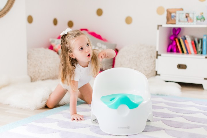 Marlowe Martino shows off her potty chair in her bedroom