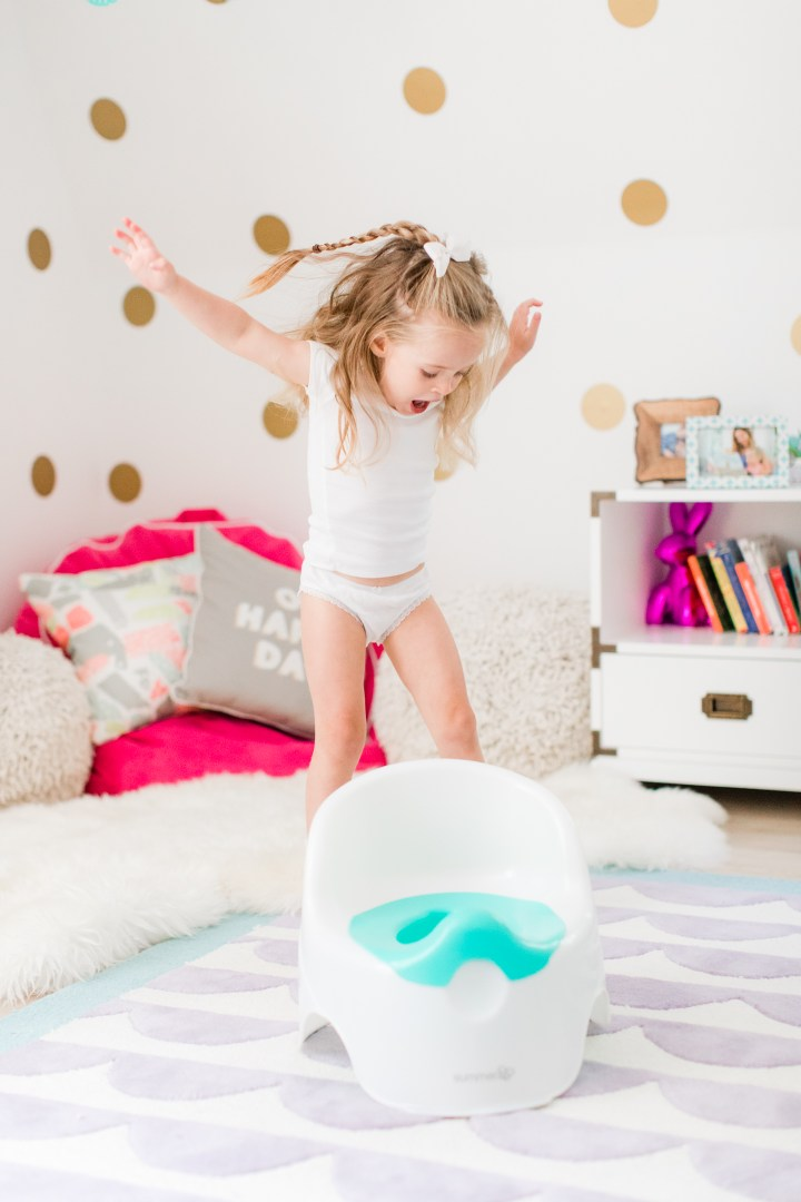 Marlowe Martino jumps for joy with her potty chair