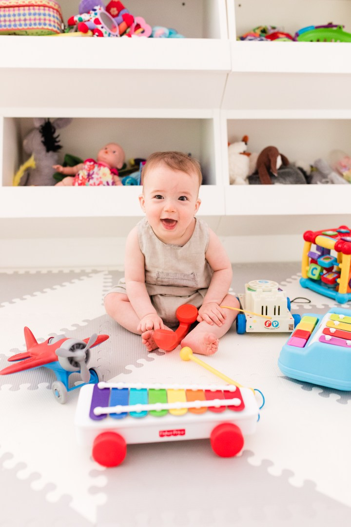 Eight month old Major Martino sits among his colorful toys at home in Connecticut