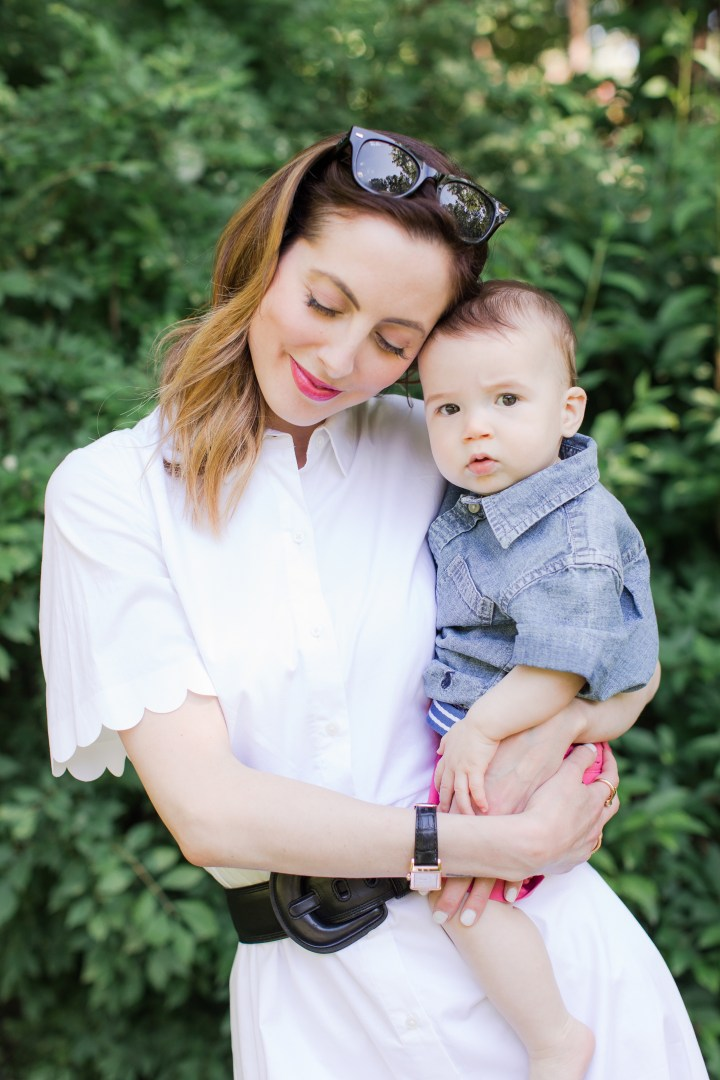 Eva Amurri Martino embraces eight month old son, Major, in the yard of her connecticut home