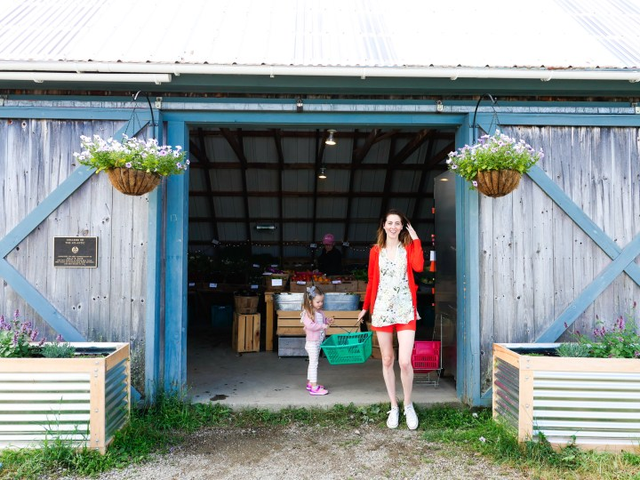 Eva Amurri Martino picks up some produce at the farm stand at Beech Hill Farm in Maine