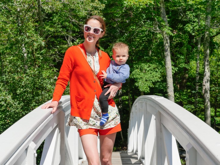 Eva Amurri Martino crosses a scenic bridge in Bar Harbor Maine, with 9 month old son Major on her hip