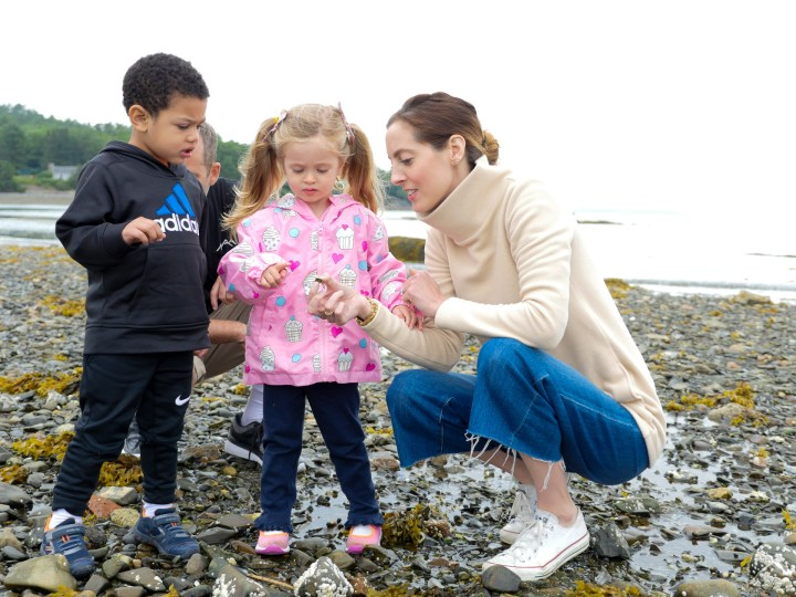Eva Amurri Martino explores tidal pools with two year old daughter Marlowe on the beach in Maine