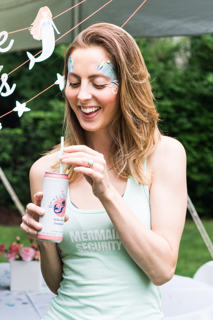 Eva Amurri Martino enjoys a cocktail at Marlowe Martino's third birthday party
