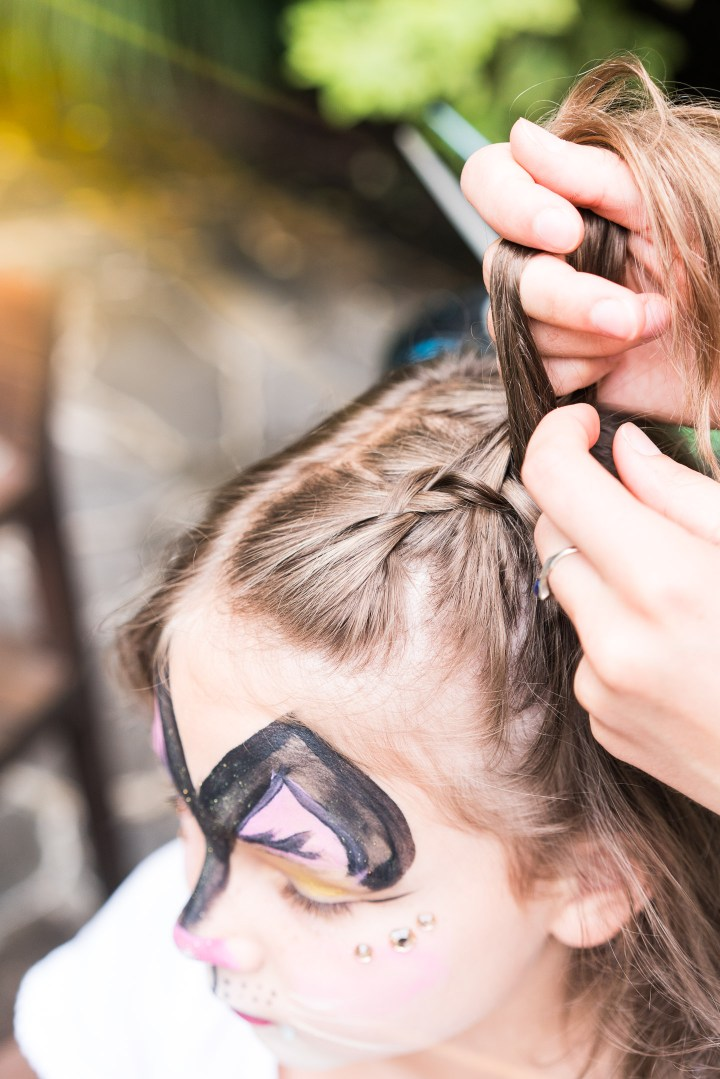 Guests get their hair braided at Marlowe Martino's third birthday party