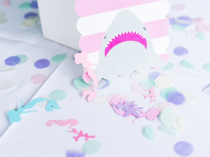 The pink and white shark invitation to Marlowe Martino's third birthday party
