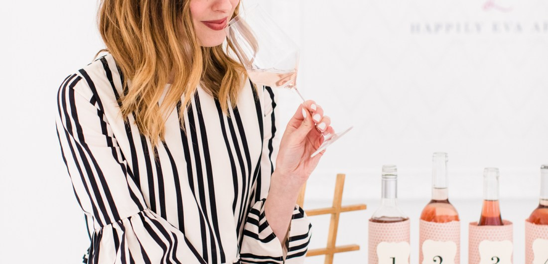 Eva Amurri Martino wears a black and white dress and tastes a rosé wine
