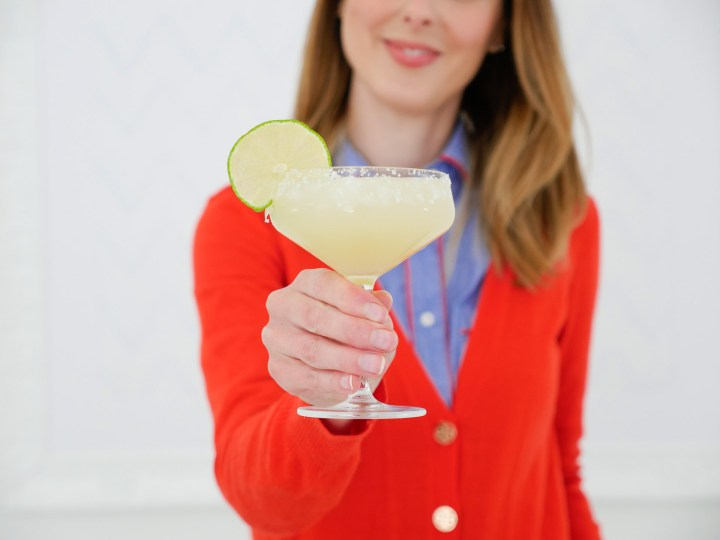 Eva Amurri Martino holds up a frosty margarita, garnished with a lime