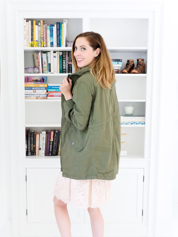 Eva Amurri Martino wears an olive green hooded anorak jacket over a black tank top