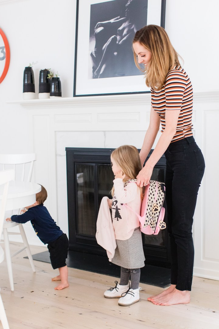 Eva Amurri Martino helps three year old daughter Marlowe to put on her backpack as they prepare for the first day of Preschool