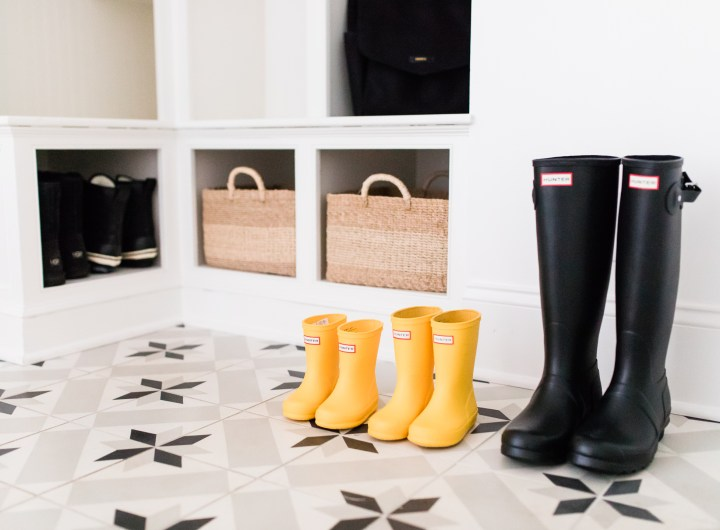 The black and white tiled mud room, with natural woven accents, in Eva Amurri Martino's Connecticut home