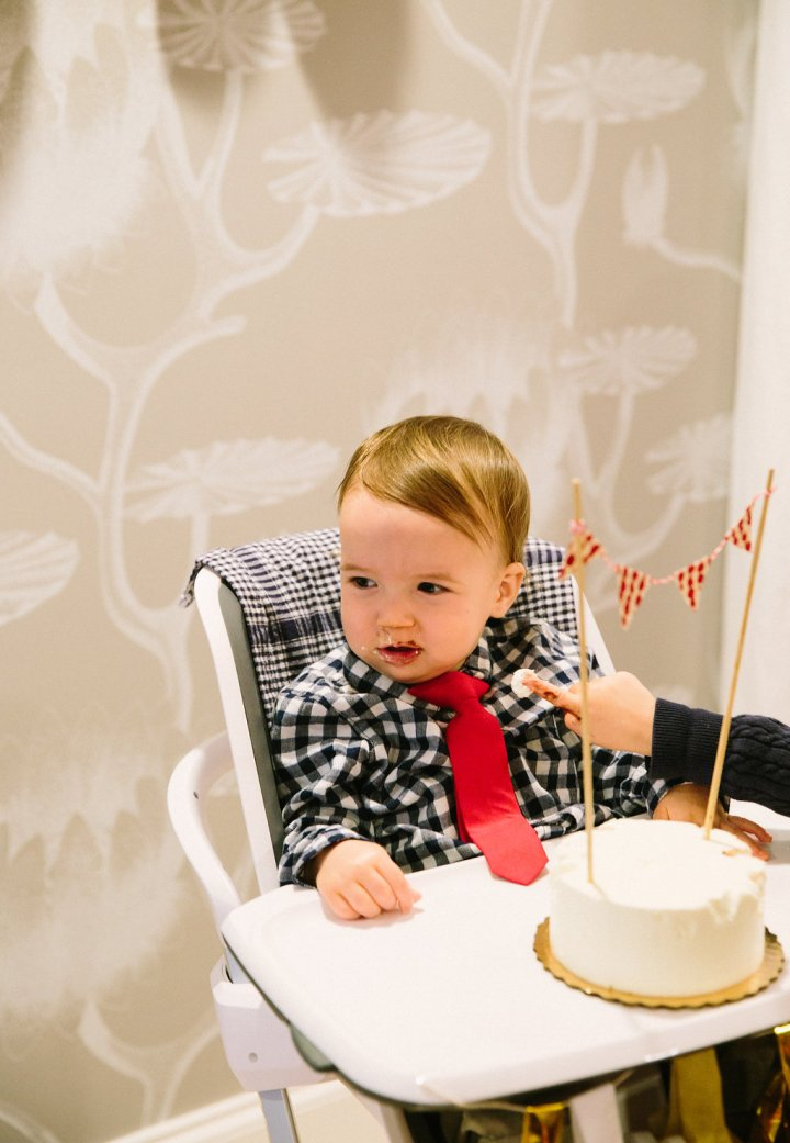 Major Martino eats his first taste of cake during his first birthday party