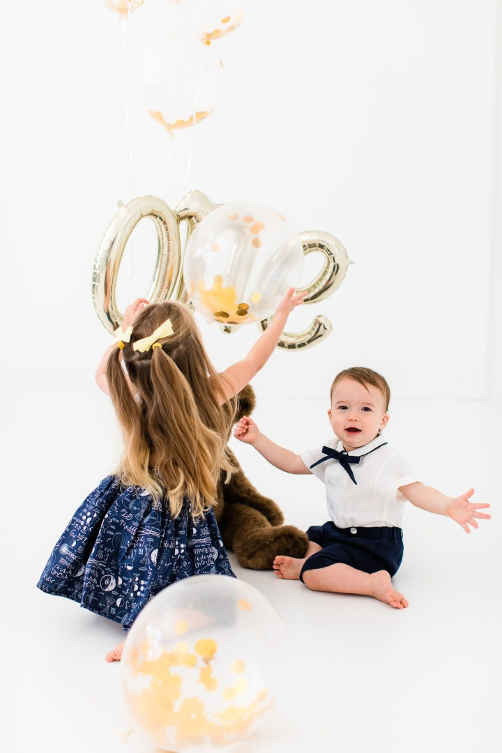 Marlowe and Major Martino play with balloons during the portraits for Major's first birthday