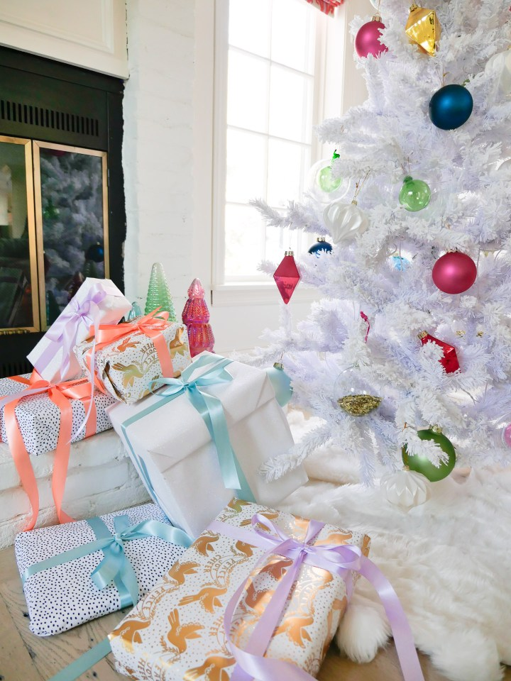 The white and pastel colored christmas tree and gifts in the family room of Eva Amurri Martino's Connecticut homeChristmas tree