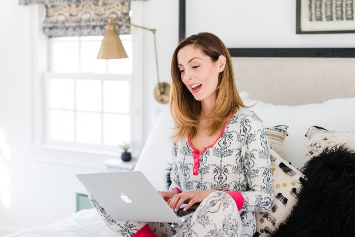 Eva Amurri Martino relaxes in bed wearing pajamas and shops on her laptop for Black Friday sales