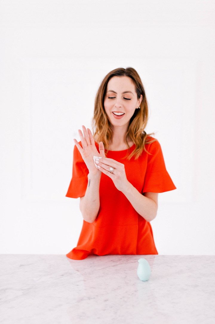 Eva Amurri Martino uses the cute packaging of Birdie hand santizer to clean her hands