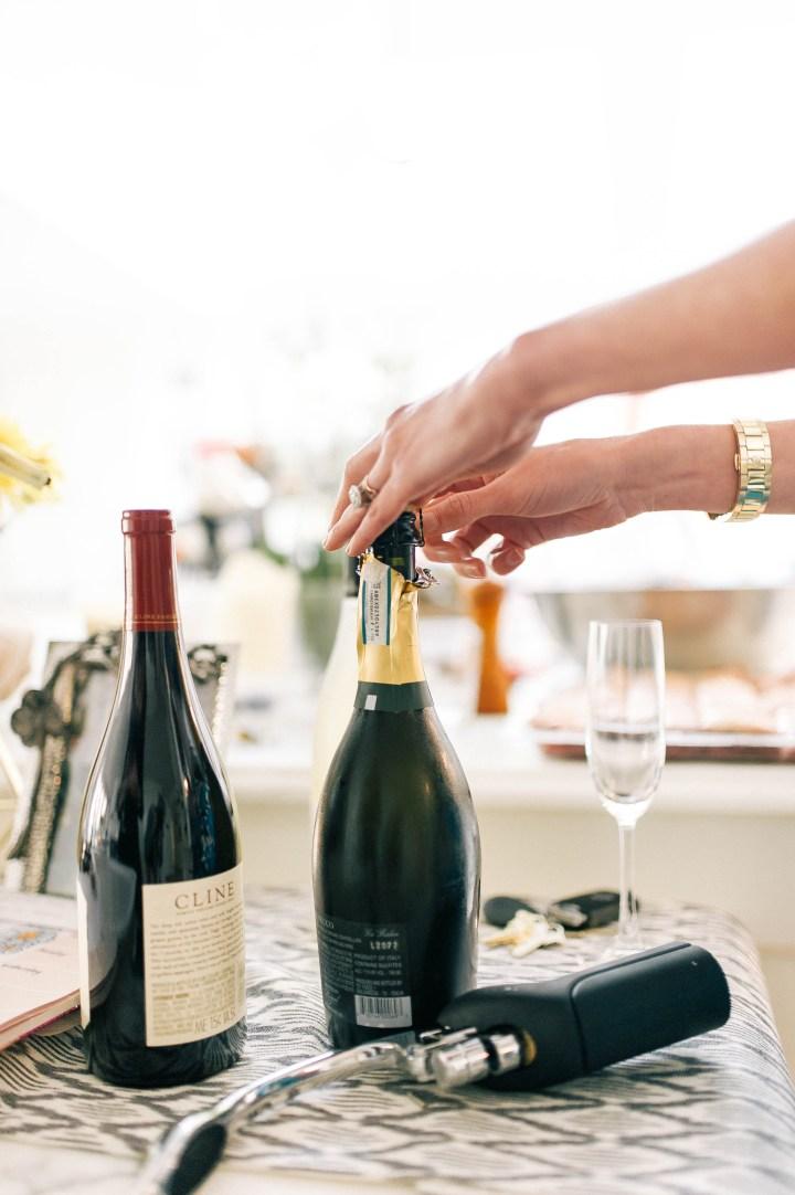 Eva Amurri Martino opens a bottles of prosecco
