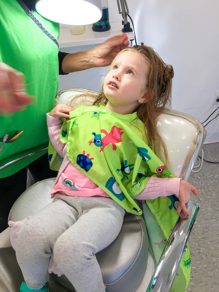 Marlowe Martino gets her hair checked for lice