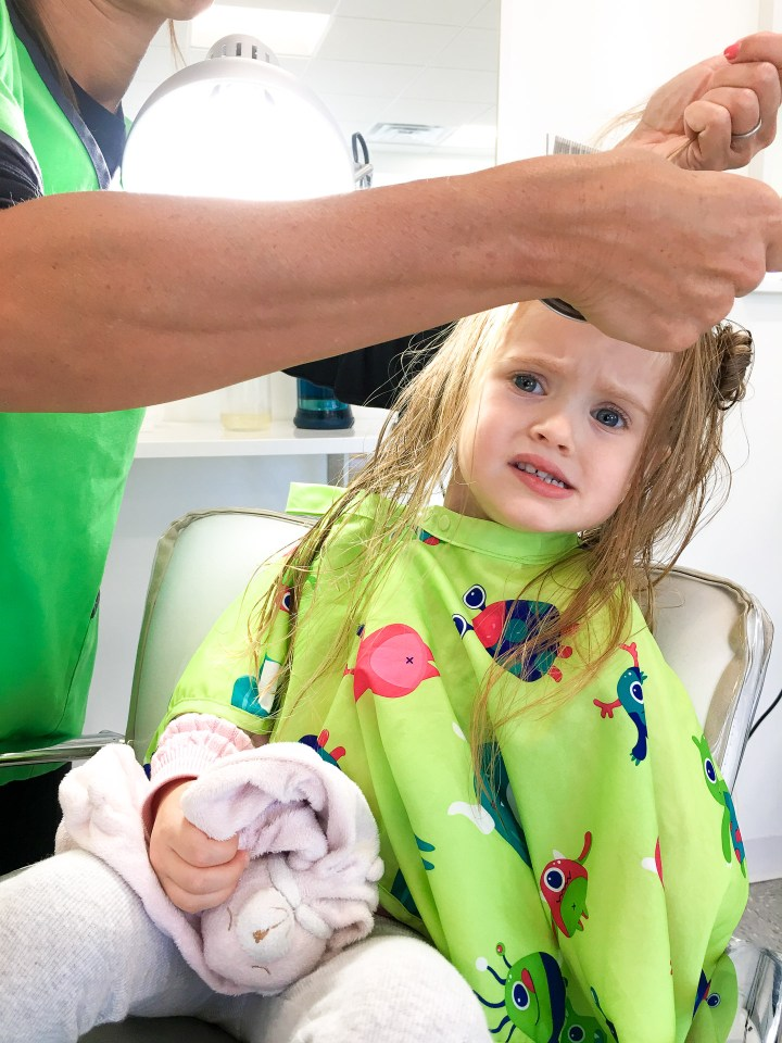 Marlowe Martino gets her hair treated for lice at a special salon in Connecticut