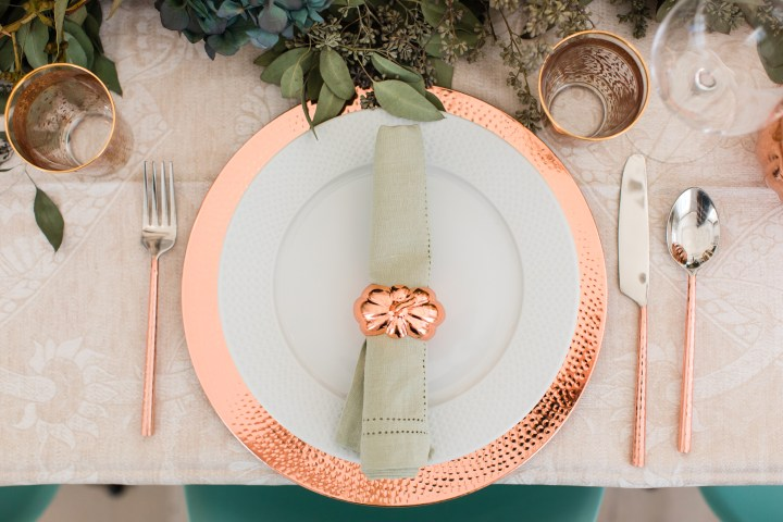 Copper pumpkin napkin rings on the place settings for Eva Amurri Martino's thanksgiving table