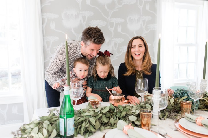 Eva Amurri Martino sits at her Thanksgiving table with husband Kyle Martino and children marlowe and major martino
