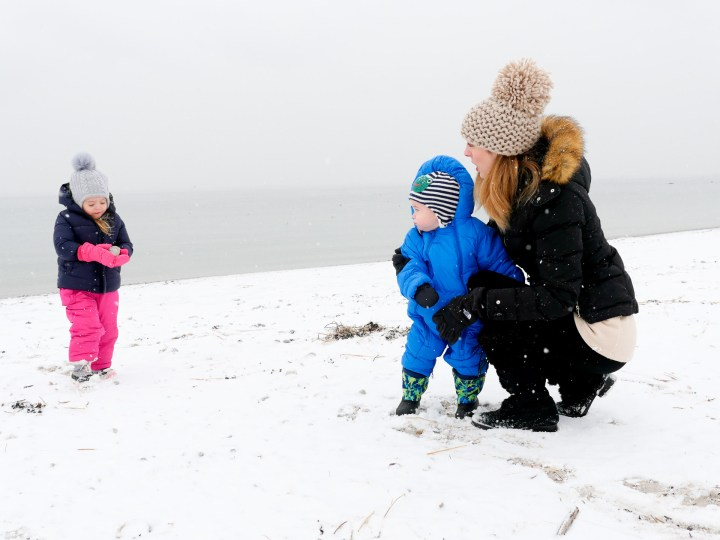 Eva Amurri Martino is playing bundled up on the snowy beach with her two children, Marlowe and Major, in Westport CT