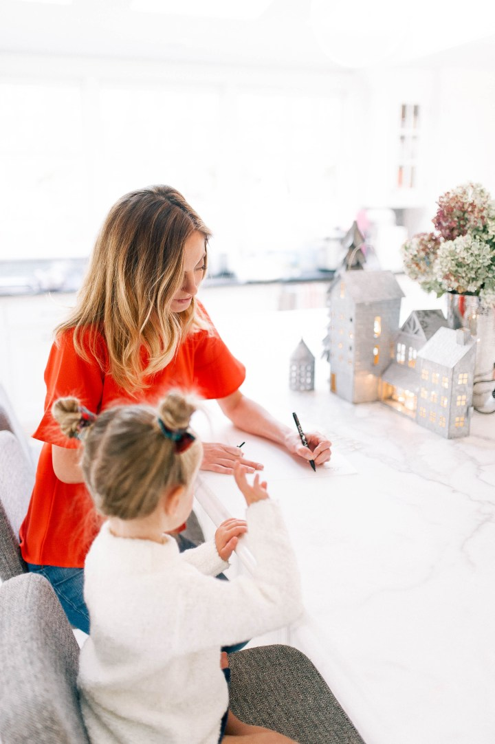 Eva Amurri Martino helps three year old daughter Marlowe write a letter to Santa