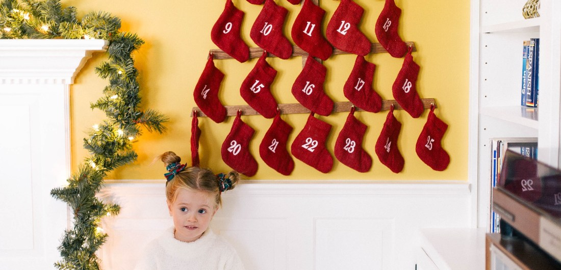 Marlowe Martino stands in front of her family advent calendar
