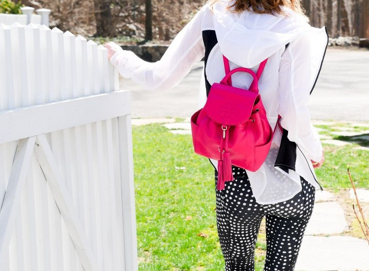Eva Amurri martino wears black and white polka dot workout pants, a white windbreaker, and Ray Ban sunglasses as she heads off for a workout in Connecticut