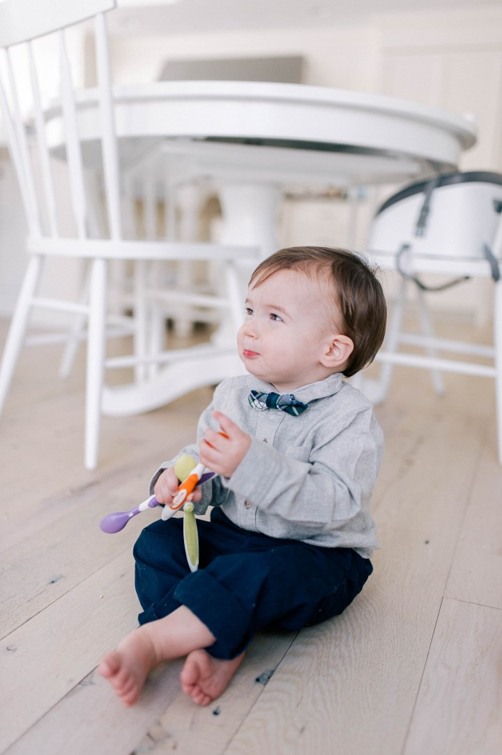 Major Martino sits on the hardwood kitchen floor in his Connecticut home and holds toddler feeding spoons