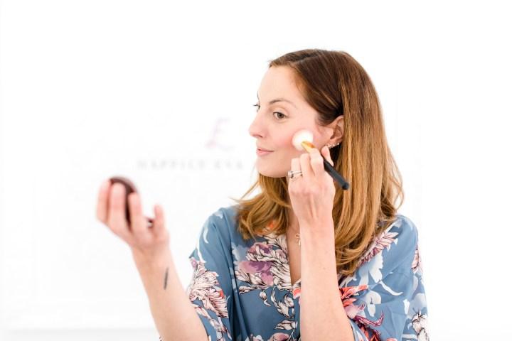Eva Amurri Martino applies blush to the apples of her cheeks and cheekbones as part of her photo shoot beauty tutorial