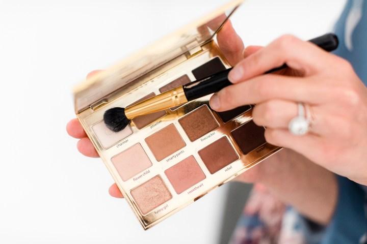 Eva Amurri Martino applies eyeshadow as part of her photo shoot makeup tutorial