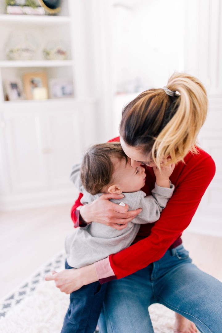 Eva Amurri Martino snuggles one year old son Major before getting him ready for bath time