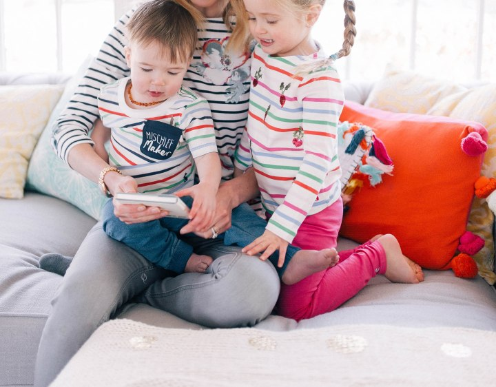 Eva Amurri Martino and her two children snuggle on the couch and read Peter Rabbit