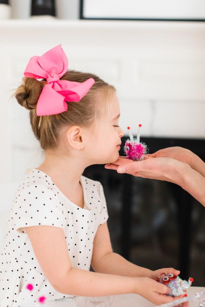 Marlowe Martino kisses a little pom pom Lovebug