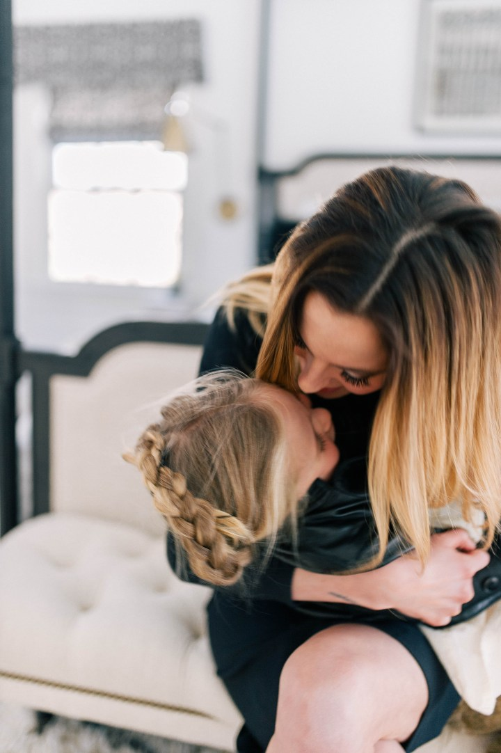 Eva Amurri Martino gives her daughter Marlowe Mae a big kiss on the forehead in their Connecticut home.